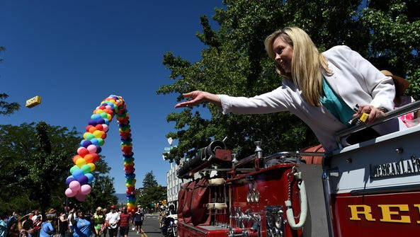 Reno Mayor Hillary Schieve throws candy during Northern