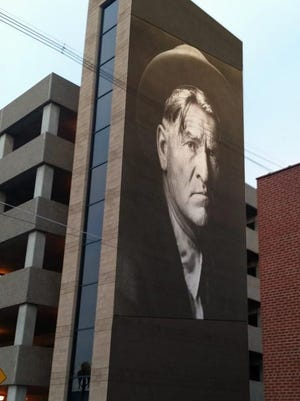 A rendering of the planned Charlie Russell mural on the city's north parking garage.