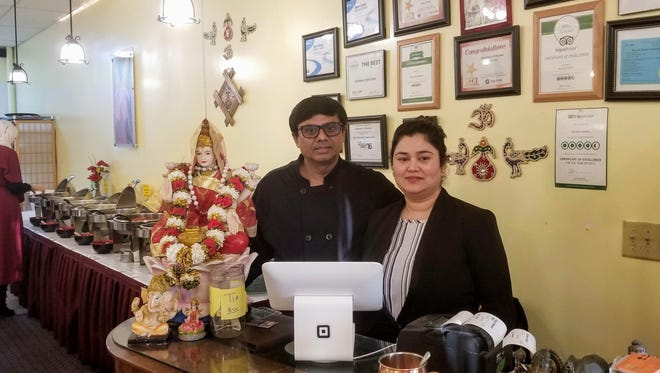 Mr. Satinder Sharma (chef) and Ms. Ruchi Sharma, owners of Sharma's Kitchen.