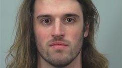 Suspended UW-Madison student Alec R. Cook is accused