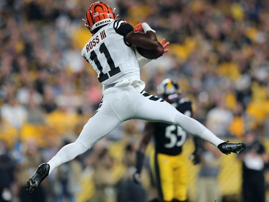 Cincinnati Bengals wide receiver John Ross (11) completes a catch in the second quarter of an NFL Week 4 game against the Pittsburgh Steelers, Monday, Sept. 30, 2019, at Heinz Field in Pittsburgh. Pittsburgh Steelers lead 10-3 at halftime.  Cincinnati Bengals At Pittsburgh Steelers Sept 29 Monday Night Football