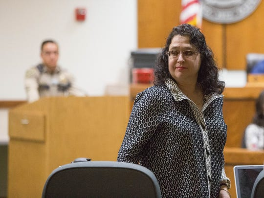 Francesca Estevez, sixth judicial district attorney, leaves the courtroom at the Third Judicial District Court, after a hearing Friday November 17,2017. Estevez has been accused of reckless driving and using her public office to attempt to evade investigation.