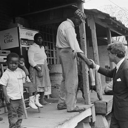 Sen. Robert F. Kennedy (D-N.Y.), offers a handshake