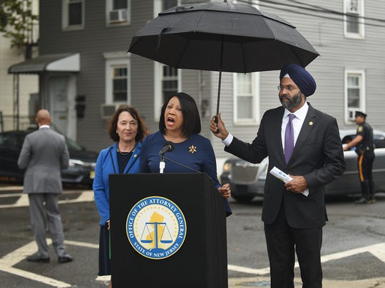 New Jersey Department of Environmental Protection Commissioner Catherine R. McCabe, Acting Governor Sheila Oliver and state Attorney General Gurbir Grewal announce lawsuits focused on contaminated properties during a press conference in Newark on Wednesday.
