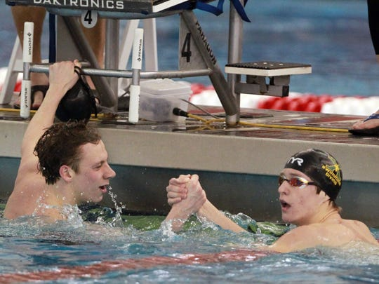 St Xavier swimmer Aldan Johnston (L) celebrates with Will Cole (R) after winning the 200 yard freestyle at the 2018 KHSAA Boys State Swimming Championship at the Ralph Wright Natatorium in Louisville, Kentucky,       February 24,  2018.