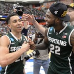 MSU seniors Travis Trice, left, and Branden Dawson celebrate after MSU's 76-70 win over Louisville Sunday in the NCAA tournament East Regional final. The Spartans' unexpected Final Four run has helped out a lot of brackets locally.