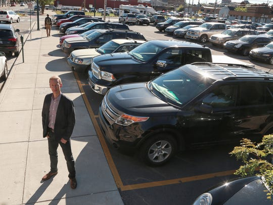 Erik Falconer, Traverse City business owner, school board member and codeveloper of the controversial Pine Street project, stands at the parking lot where the proposed nine-story condo building would be built at the corner of Pine and W. Front St. on the edge of downtown Traverse City.