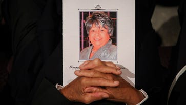 An attendee at the funeral service of Sen. Georgia Powers at the St. Stephen Church holds a program bearing a photograph of the former Senator Friday. Feb. 4, 2016