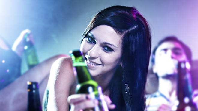 Girl partying with beer bottle.