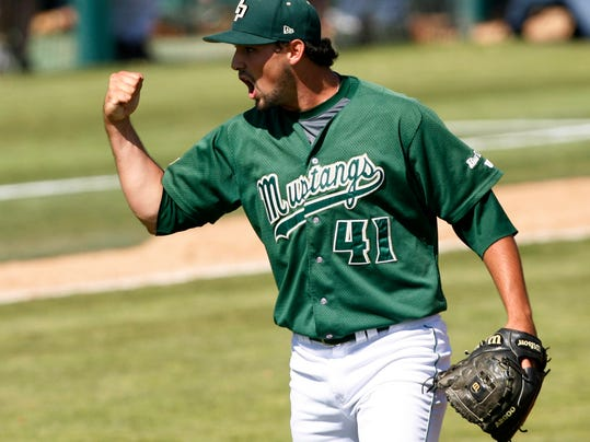 Cal Poly closing pitcher Reed Reilly celebrates after the final out against Sacramento State in an NCAA college baseball tournament regional game on Sunday, June 1, 2014, at Baggett Stadium at Cal Poly in San Luis Obispo, Calif. Cal Poly won 6-5. (AP Photo/Aaron Lambert)