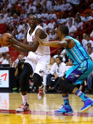 Luol Deng #9 of the Miami Heat drives on Kemba Walker #15 of the Charlotte Hornets  during Game One of the Eastern Conference playoffs.