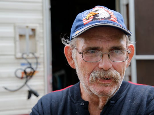 Thomas Hood is photographed outside his RV where he lives near the White River in Spencer, Ind.