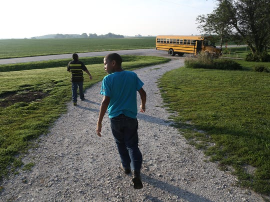 Kaleb, right, and Nate Scott walk down the driveway of their home near Pilot Mound to meet the bus on the first day of school in the Southeast Webster Grand district Aug. 19.