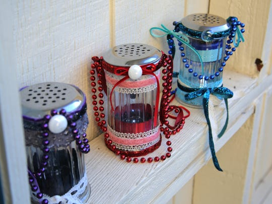 Dollar store solar light stakes go glam when placed into glass shaker jars and embellished with ribbon.