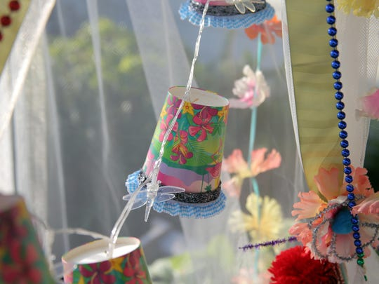 Dress up battery-operated LED lights with pretty paper cups and added embellishments.