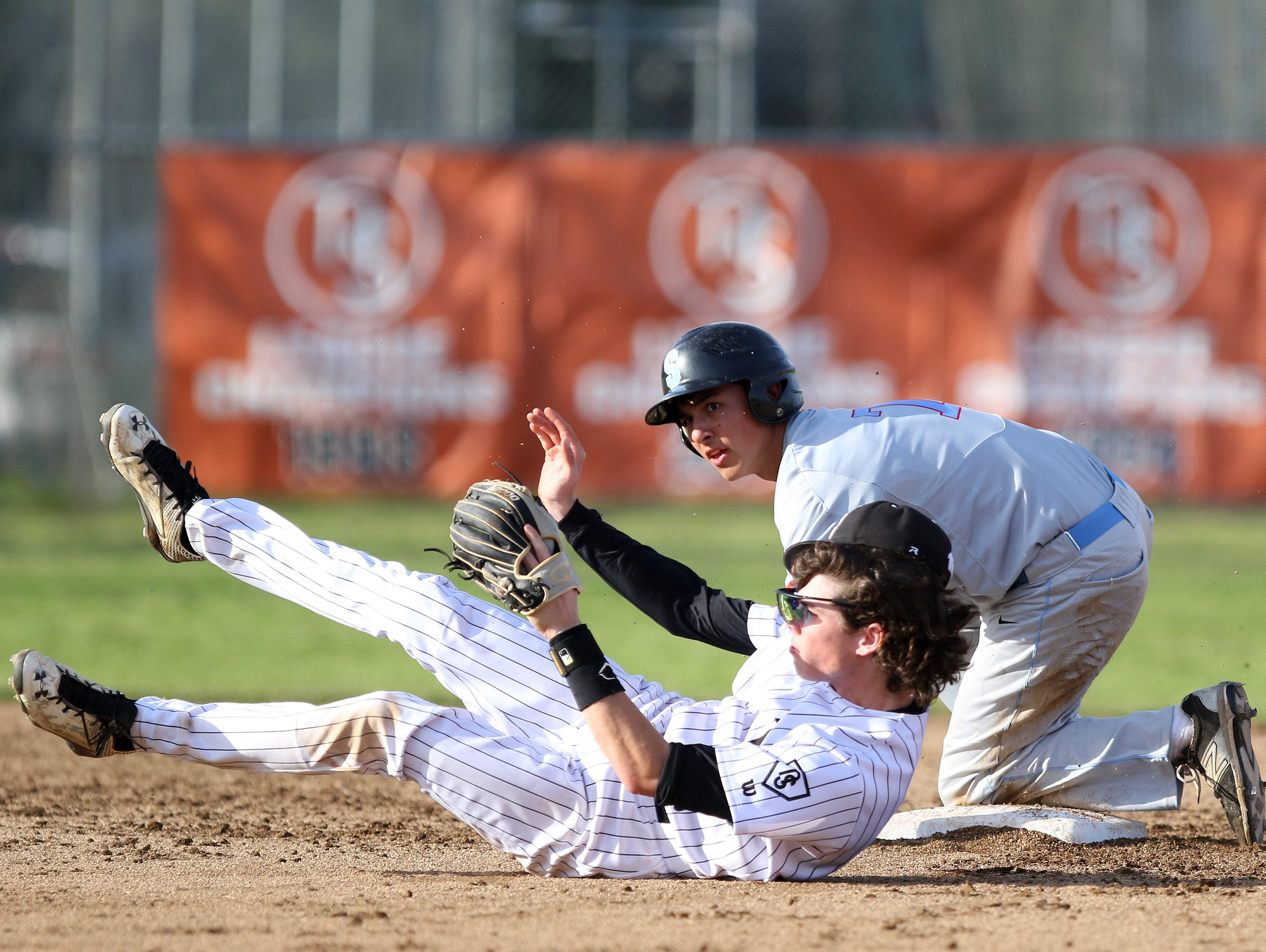 South Salem's Aaron Zavala collides with North Salem's Noah Boatwright at second base as the Saxons defeat North Salem 8-1 on Friday, April 8, 2016, during a Greater Valley Conference game.