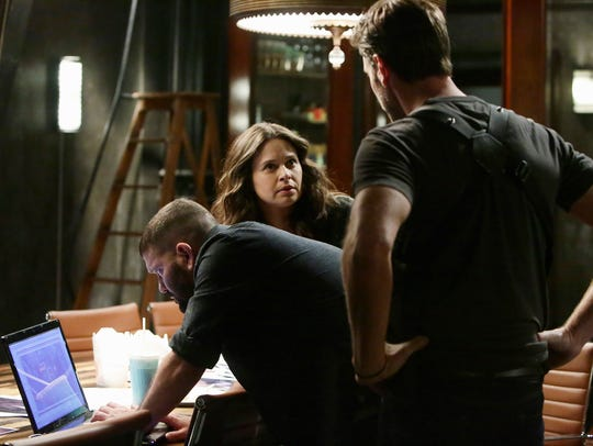 Guillermo Diaz, left, Katie Lowes and Scott Foley in