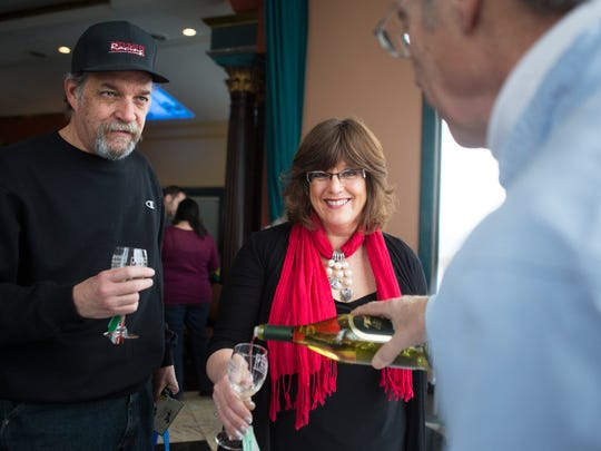 Larry Pryor and Kay Loree-Pryor of Canandaigua sample a wine at the Ice Wine Festival at Casa Larga Vineyards in 2015.