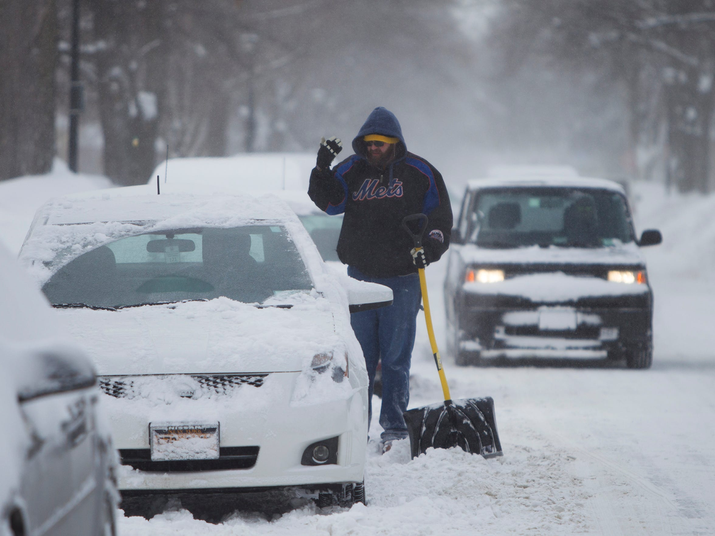Sean Conlon helps his friend dig his car out on Vick Park A on Sunday, February 15, 2015.