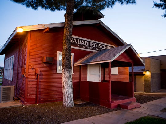 A red schoolhouse built in 1921 is part of the Nadaburg