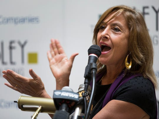 City Councilmember Elaine Spaull speaks at the opening
