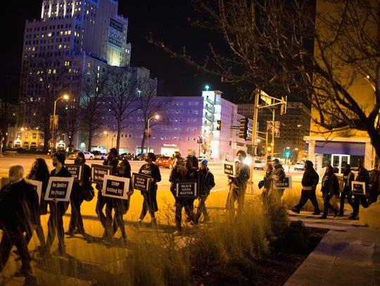 Ferguson, Mo., activists march through downtown St.