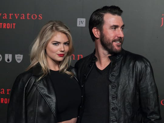 Model Kate Upton, left, and Detroit Tigers pitcher Justin Verlander, right, walk the black carpet during the grand opening celebration of the Woodward Avenue John Varvatos store on Thursday, April 16, 2015 in downtown Detroit.