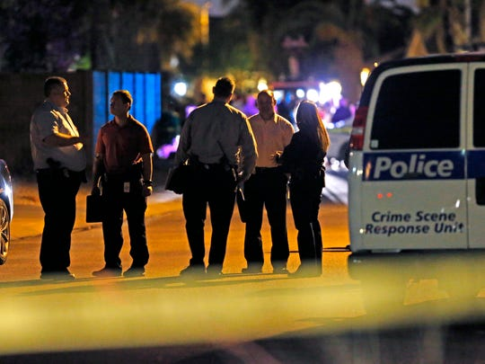 Phoenix police investigate a multiple homicide in the 4300 block of East Anderson Drive Thursday, April 16, 2015, in Phoenix.