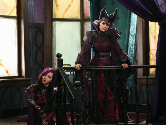 "Dove Cameron, left, and Kristin Chenowith star as Mal and her wicked mom Maleficent in ""Descendants."""