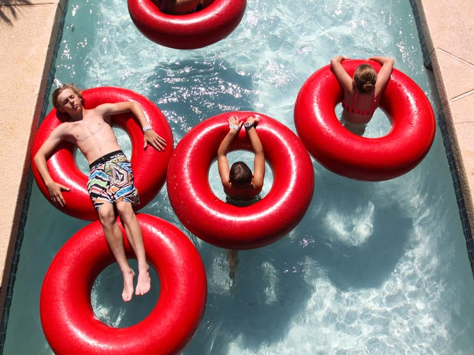 Kids float down the lazy river at Golfland Sunsplash
