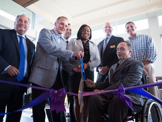 Mayor Lovely Warren cuts the ribbon with Strathallan