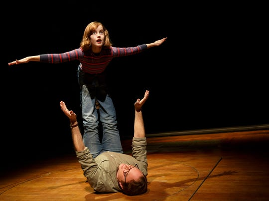 "Sydney Lucas, top, and Michael Cerveris in a scene from the musical play ""Fun Home."""