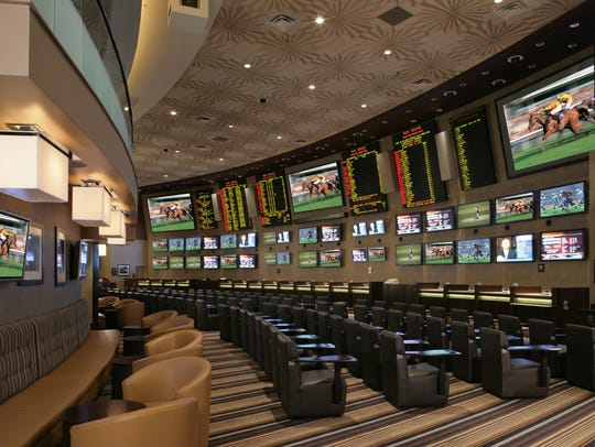 MGM Grand's race and sports book seats 104 with 60