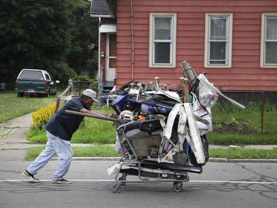 Scrap collector Preacher Atkins rolls his cart along
