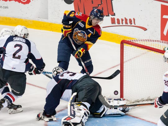 Dylan Strome of the Erie Otters pops the puck over