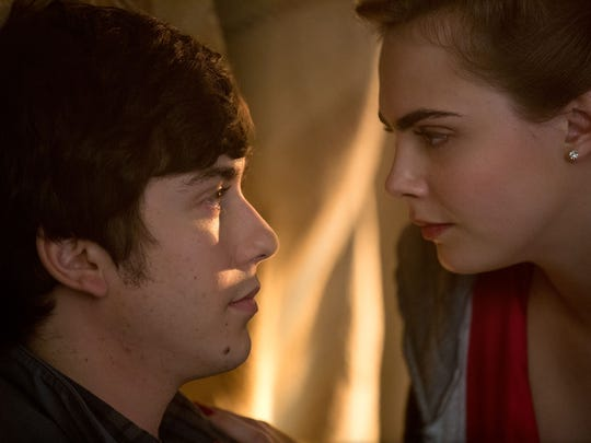 Cara Delevingne (right) stars as the enigmatic Margo to Nat Wolff's Q in 'Paper Towns.'