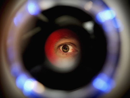 FILE PHOTO:  A man uses an iris recognition scanner