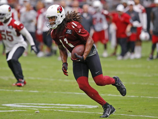 Larry Fitzgerald looks for the end zone during the