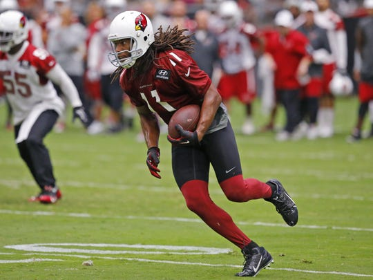 Larry Fitzgerald looks for the end zone during the first full day of training camp on Saturday.