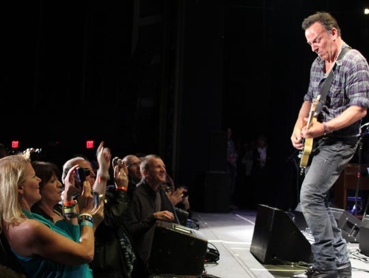 Bruce Springsteen on stage at the Paramount Theatre