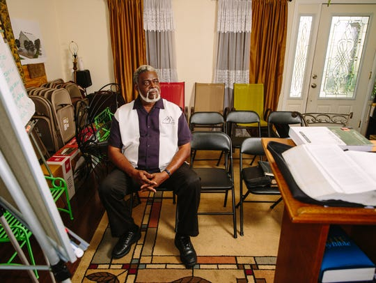The Rev. Charles Duplessis, 64, sits for a portrait
