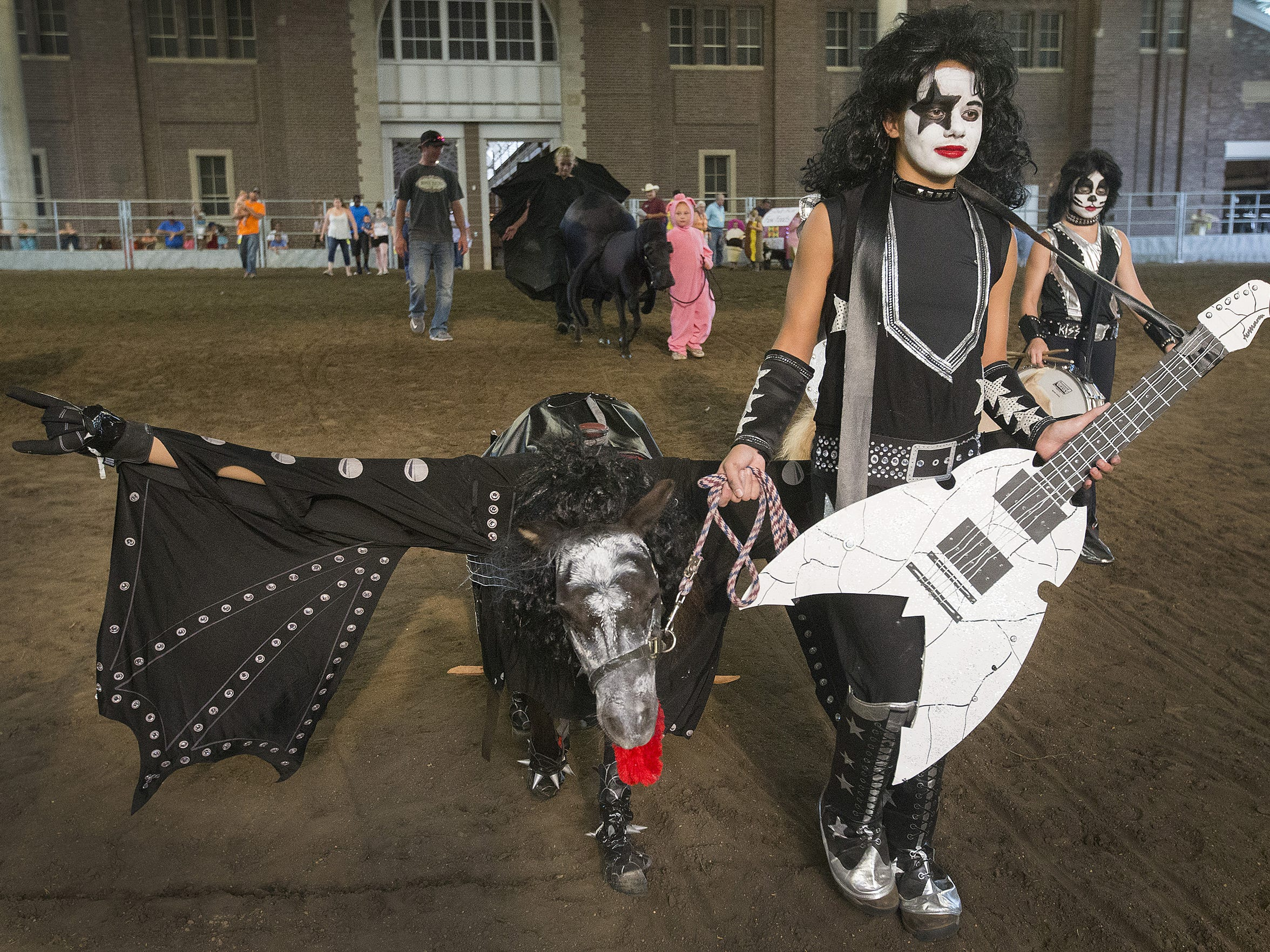 Simply an awesome fair photo: Dressed as Ace Freely from KISS, Joelle Grubbs, 15, of Casey, Iowa, and her sister Quinn, 10, walked their miniature horse, Echo, dressed as Gene Simmons during children's costume class at the horse show in the Richard O. Jacobson Exhibition Center at the Iowa State Fair in Des Moines, Iowa, Sunday, Aug. 16, 2015.