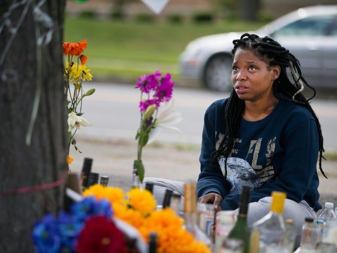 Desirae Britt talks to the memorial for Johnny Johnson