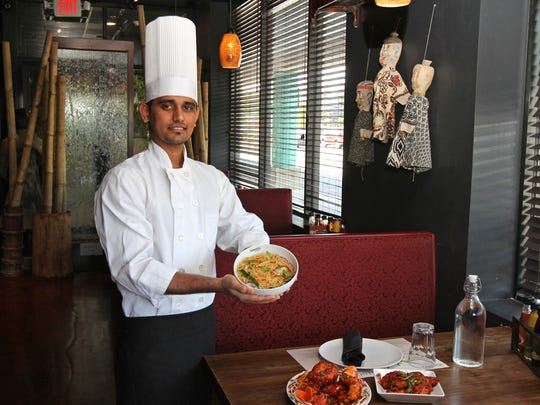Chef Rahul displays several lunch items at Inchin's Bamboo Garden in South Plainfield.