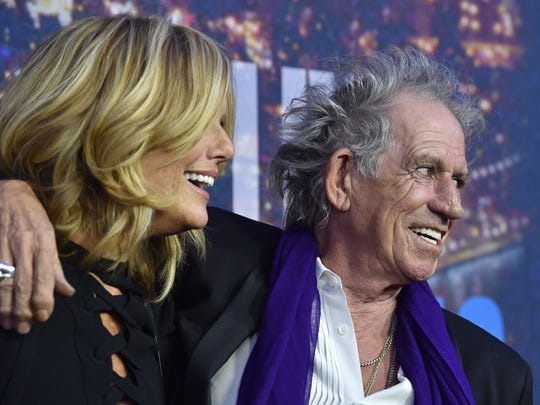 """Patti Hansen, left, and musician Keith Richards in New York on February 15, 2015. Richards his set to release """"Crosseyed Heart,"""" his first solo album in nearly 25 years and a rare venture away from his musical identity with the Rolling Stones. (Anthony Behar/Sipa USA/TNS)"""