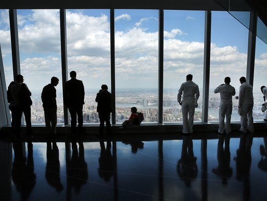 People look out from the newly built observation deck