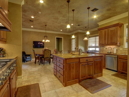The kitchen has top of the line appliances and luxury