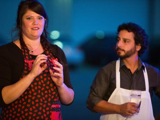 Chef Amelia Mouton explains the third course as Raffi Jergerian looks on at the Secret Supper held at Bas Blue Theatre Wednesday, September 30, 2015.