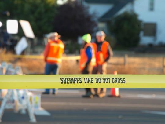 Crime scene tape limits access to Umpqua Community
