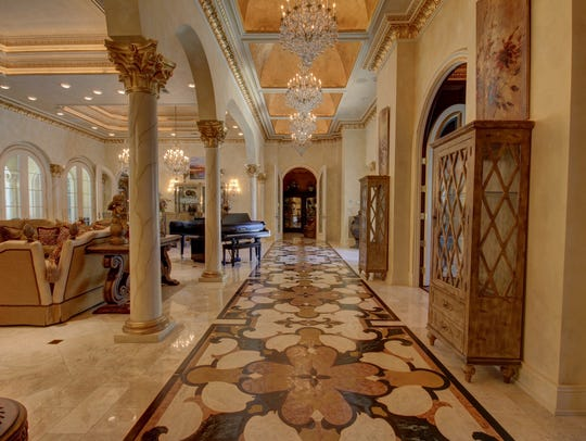 Gold leaf and crystal chandeliers make this mansion
